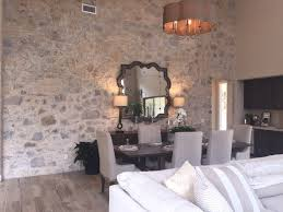 textured walls fresh ideas for the accent wall what s hot by the image above is a dining room with an accent wall made of stone the rustic ranch style room can keep it s neutral palette yet it attains a wow factor
