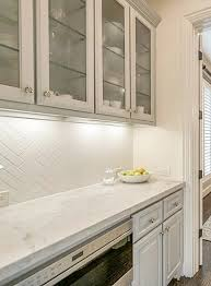 white kitchen cabinets with glass doors on top how to style the glass cabinet doors in your kitchen designed