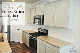 gray painted kitchen cupboards we painted our brand new kitchen cabinets and here s how it