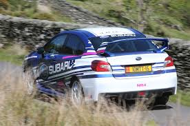 subaru sti rally car ripping around the isle of man in subaru wrx sti rally cars photo