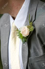Lapel Flowers A Grooms Wedding Boutonniere In Pink And Green Lapel Flower Stock