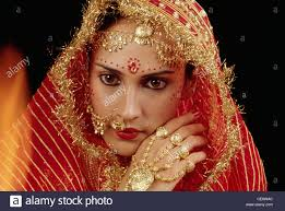 nna 85215 indian wearing gold jewellery gold nose