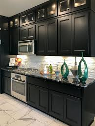 Walzcraft Cabinet Doors by Black Kitchen Cabinets Contrast With White Backsplash And Floors