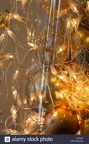 Christmas Lights In A Vase by Christmas Lights And Gold Baubles In Vase Stock Photo Royalty