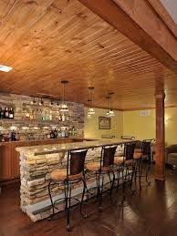 basement irish pub love the black cabinets and using the corner