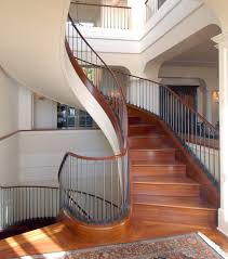 stone staircase design contemporary with curved ceiling pendant
