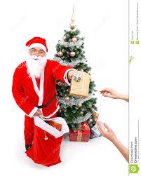 santa claus giving a gift stock photos image 16847703