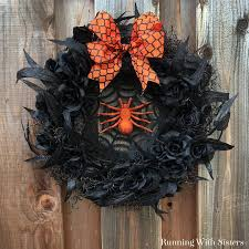 halloween spider wreath running with sisters