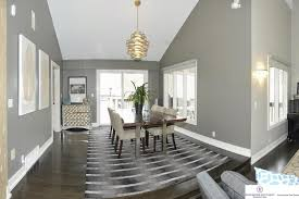contemporary dining room with pendant light hardwood floors in