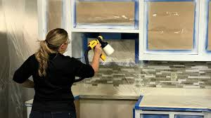 is it better to paint or spray kitchen cabinets how to paint kitchen cabinets with a paint sprayer