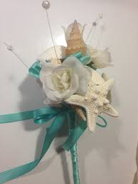 wedding bouquets with seashells wedding seashell wand flowergirl bouquet bridesmaids