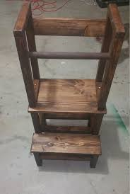 a kids step stool enables a child to reach up safely