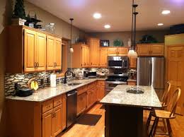 Foil Kitchen Cabinets After Photo Santa Cecilia Granite Countertops Oil Rubbed Bronze