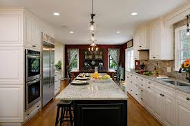 kitchen with black island and white cabinets white kitchen cabinets with black island and