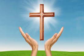 praying with a wooden cross stock image image of