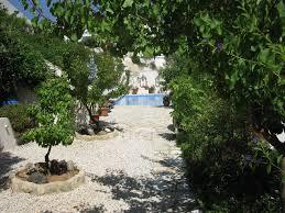 1 afroditis tsada a hillside retreat with a large pool and set