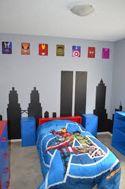 finished superhero avengers room we painted a cityscape on the