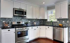 white kitchen cabinets with white backsplash easy step diy painting kitchen cabinets white newgomemphis