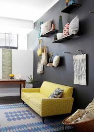 how to design with and around a yellow living room sofa yello and grey sofa with black wall