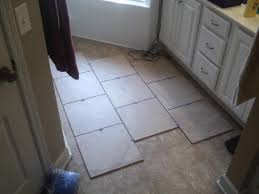 remove vinyl and underlayment before installing tile