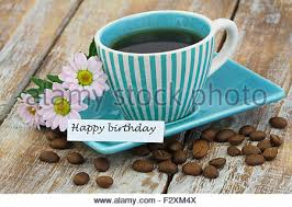 happy birthday card with coffee and pink orchid stock photo
