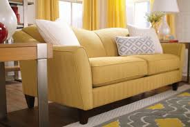 Table With Sofa Furniture Lazyboy Sofas Yellow With White Pillows And A Wooden
