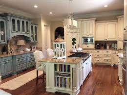 french country kitchen cream cabinets light blue walls and black
