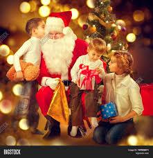 santa claus giving christmas gifts image u0026 photo bigstock