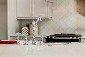 kitchen with white arabesque backsplash transitional kitchen