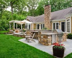 Backyard Grill Area by Spanish Influenced Raised Stone Patio Beechwood Landscape