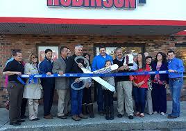 grand opening ribbon robinson s ace rental place grand opening ribbon cutting