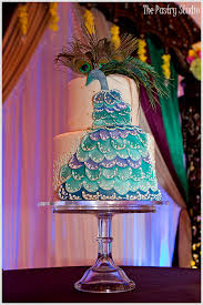 A Beautiful Indian Wedding With A Peacock Themed Wedding Cake By