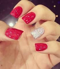 red party nail design with one white glitter nail nails