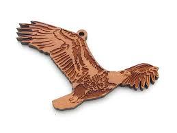 soaring bald eagle ornament nestled pines