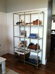excellent corner shelving unit with curved wooden rack and tower
