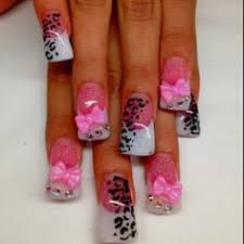 flared pink and white acrylic nails with zebra and leopard print