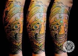 fantastic simple tibetan skull tattoo design on leg golfian com