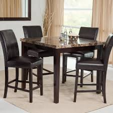 square black glossy dining table and black leather chairs with