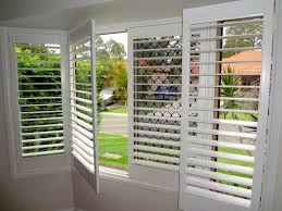 Bay Window Window Treatments Hinged Plantation Shutters In A Bay Window Custom Made To Fit