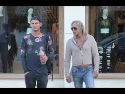 mickey rourke shows off his chest tattoos while christmas shopping