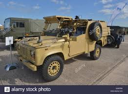 british land rover defender a british army land rover in desert colours stock photo royalty