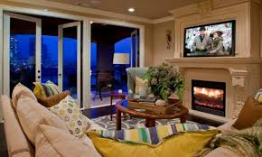 television over fireplace the pros and cons of having a tv over the fireplace