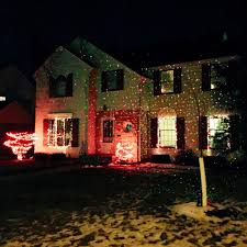 Christmas Lights Projector On House by Embrace The Darkness Streets Mn