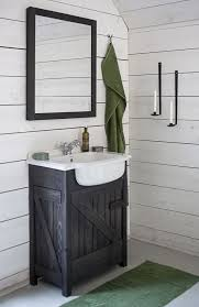 large rustic bathroom vanities with two white mirrors and sconce