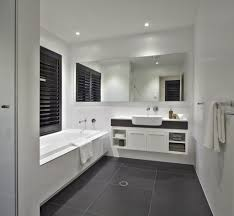 bathroom with dark tile floors charming home design