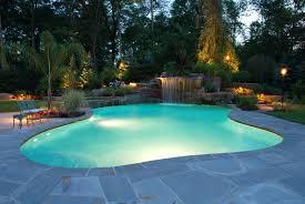interesting outdoor modern swimming pool design in green outdoor
