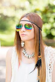hippie style portrait of beautiful young woman with sunglasses hippie style
