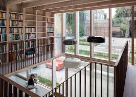 Living Room Design Library A Double Height Living Room And A Mezzanine Library Feature At
