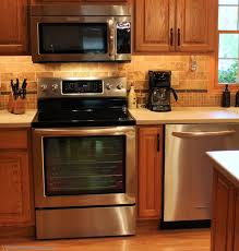 what color knobs look best on oak cabinets great kitchen showing how stainless appliances do go with