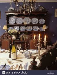 blue and white spode plates on antique oak dresser in blue dining